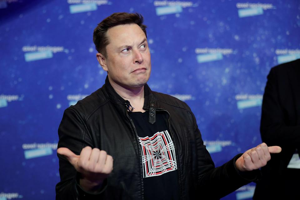 SpaceX owner and Tesla CEO Elon Musk gestures as he arrives on the red carpet for the Axel Springer Awards ceremony, in Berlin (POOL/AFP via Getty Images)