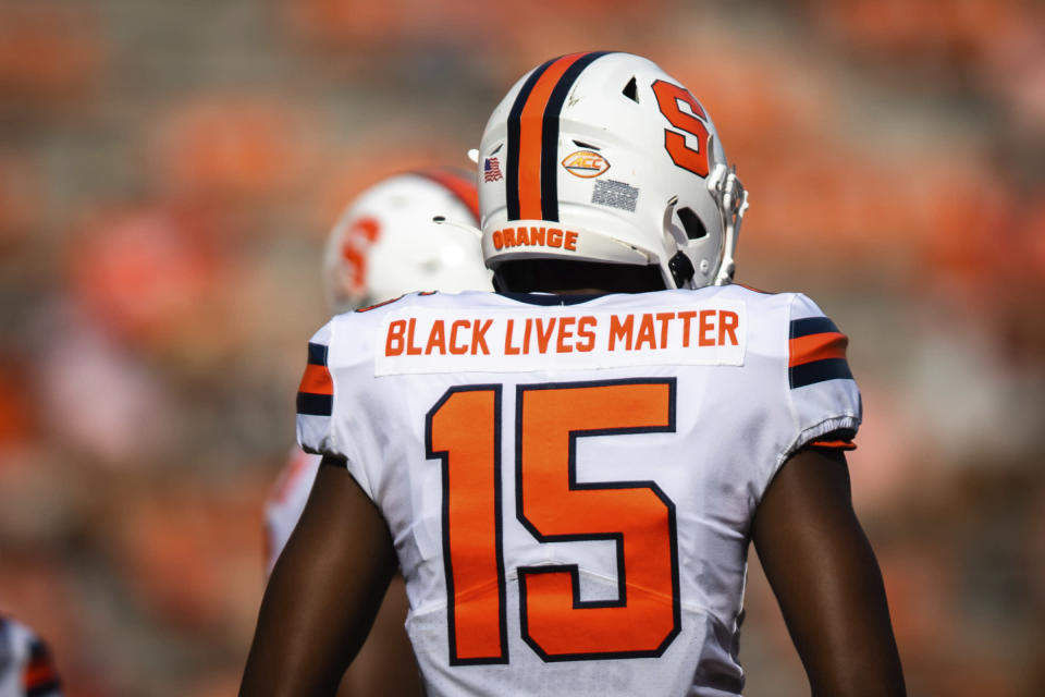 Syracuse quarterback JaCobian Morgan (15) wears a jersey with Black Lives Matter printed on the back during an NCAA college football game against Clemson in Clemson, S.C., on Saturday, Oct. 24, 2020. (Ken Ruinard/Pool Photo via AP)