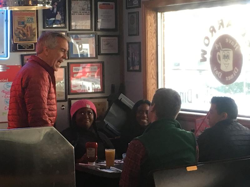 Former Republican congressman and now presidential candidate Joe Walsh (left) greets customers at the Red Arrow Diner in Manchester, New Hampshire. (Photo: S.V. Date/HuffPost)