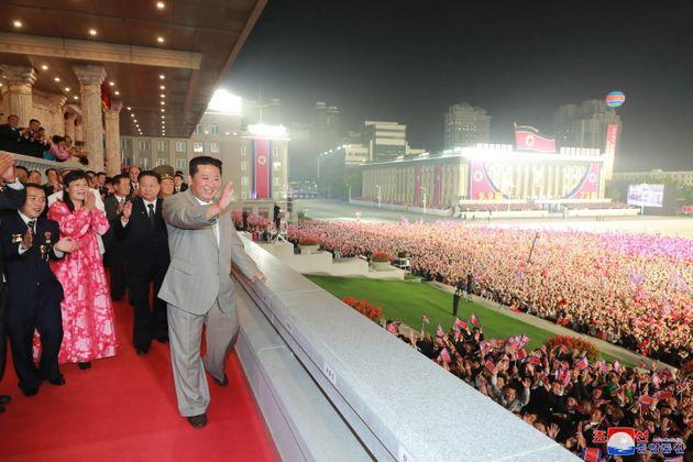 epaselect epa09456635 A photo released by the official North Korean Central News Agency (KCNA) shows North Korean leader Kim Jong-un (front) waving at the crowd during a military parade at Kim Il-sung Square in Pyongyang, North Korea, early 09 September 2021. The late-night parade was held at Kim Il Sung Square to celebrate the 73rd founding anniversary of the Democratic People's Republic of Korea.  EPA/KCNA   EDITORIAL USE ONLY (Photo: KCNA EPA)