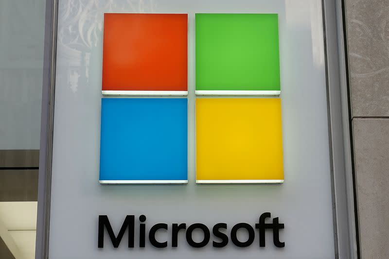 FILE PHOTO: A Microsoft logo is pictured on a store in New York