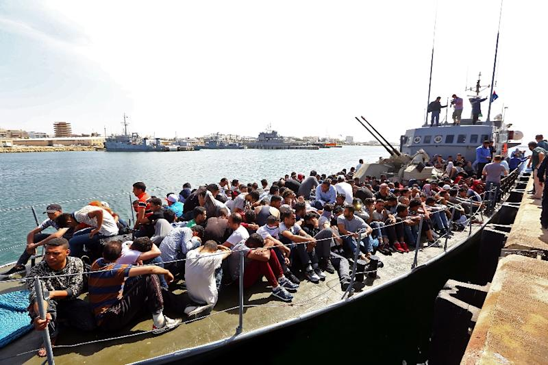 Migrants whose boat was intercepted by the Libyan coastguard in the Mediterranean arrive at a naval base in the capital Tripoli on May 10, 2017