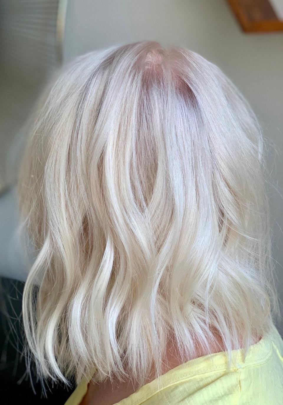 "While fall usually means warmer tones, get a jump on winter weather by going ice queen platinum. ""It's so fun to cool down a summer blonde for winter,"" says <a href=""https://www.instagram.com/laurengrummel/"" rel=""nofollow noopener"" target=""_blank"" data-ylk=""slk:Lauren Grummel"" class=""link rapid-noclick-resp"">Lauren Grummel</a>, a hairstylist in New York. ""Make sure to get a fresh trim on the ends if you're super blonde, it always makes the blonde fresher and even brighter looking."""