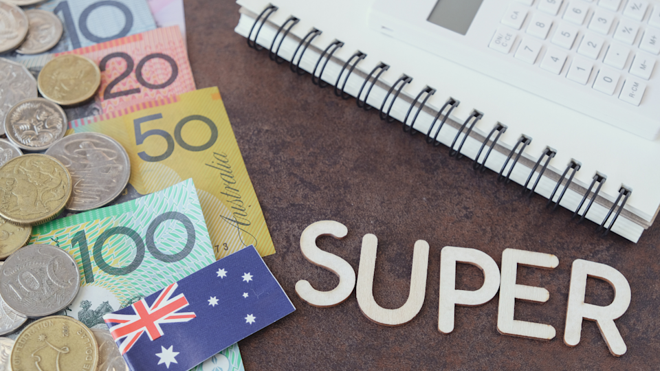 Australian money with the word 'SUPER' and a calculator