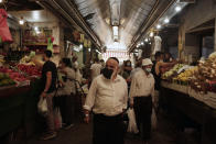 People shop in Machane Yehuda market in Jerusalem, Friday, Sept. 18, 2020, hours ahead of a nationwide three-week lockdown to curb the spread of the coronavirus. (AP Photo/Maya Alleruzzo)