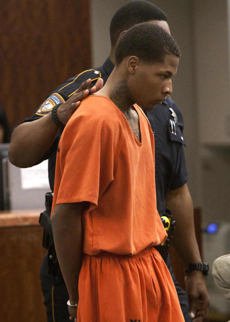 Trey Foster leaves the courtroom after his appearance in the 228th State District Court at the Harris County Criminal Courthouse Monday, Jan. 28, 2013, in Houston. Authorities took Foster, 22, into custody Friday, as a suspect in the shooting that took place on the Lone Star College campus. (Cody Duty / Houston Chronicle) (AP Photo/Houston Chronicle, Cody Duty)  MBI (REV-SHARE)