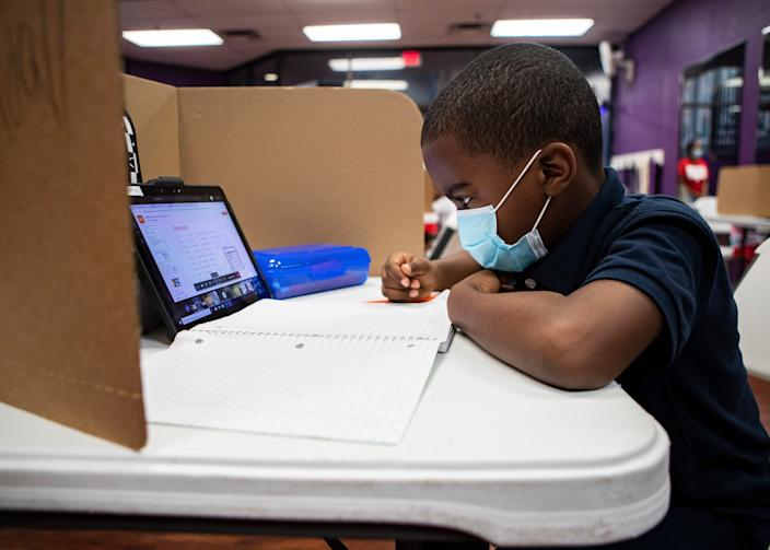 Kendall Triggs works on an assignment in a classroom at YMCA virtual learning center in Memphis on Sept. 3.