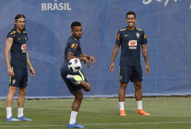Brazil's Gabriel Jesus, center, Filipe Luis, left, Roberto Firmino, practice during a training session in Sochi, Russia, Tuesday, June 19, 2018. Brazil will face Costa Rica on June 22 in the group E for the soccer World Cup. (AP Photo/Andre Penner)