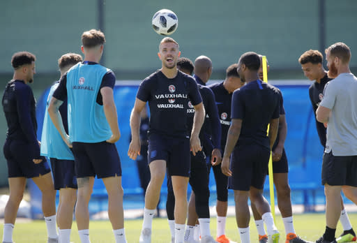 England's Jordan Henderson, centre, and his teammates attend England's official training in Zelenogorsk near St. Petersburg, Russia, Saturday, June 23, 2018 on the eve of the group G match between Panama and England at the 2018 soccer World Cup. (AP Photo/Dmitri Lovetsky)