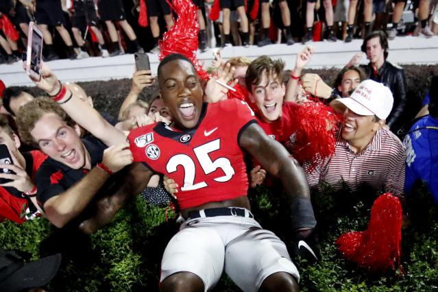 Georgia linebacker Quay Walker (25) celebrates with fans after the team defeated Notre Dame after an NCAA college football game, Saturday, Sept. 21, 2019, in Athens, Ga. (AP Photo/John Bazemore)