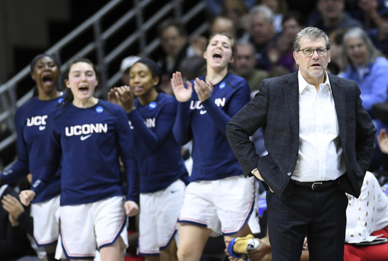 Connecticut head coach Geno Auriemma, right, leads his team from the sideline during a first round women's college basketball game against Towson in the NCAA Tournament, Friday, March 22, 2019, in Storrs, Conn. (AP Photo/Stephen Dunn)
