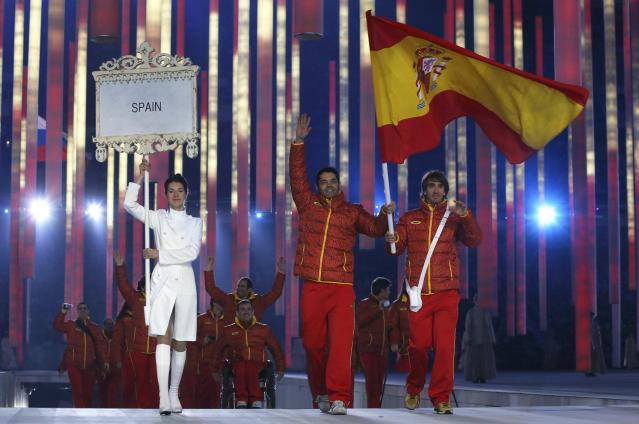 Spain's flag-bearer Yon Santacana Maiztegui (C), leads his country's contingent during the opening ceremony of the 2014 Paralympic Winter Games in Sochi, March 7, 2014. REUTERS/Alexander Demianchuk (RUSSIA - Tags: OLYMPICS SPORT)
