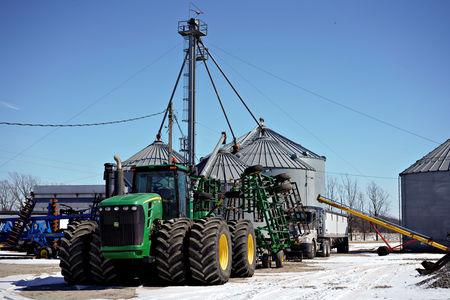 Farm equipment and grain storage belonging to farmer Austin Rincker sit outside in Moweaqua, Illinois, U.S., March 6, 2019. Rincker will farm approximately 2500 acres in the upcoming season, split evenly between corn and soybeans. Picture taken March 6, 2019. REUTERS/Daniel Acker