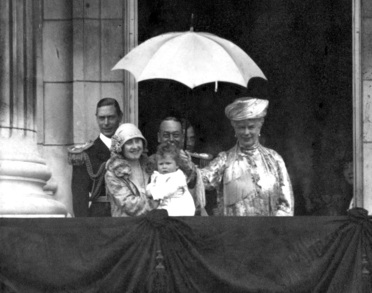 <p>The Duke and Duchess of York with King George V and Queen Mary and Princess Elizabeth, on the balcony of Buckingham Palace (PA Archive) </p>