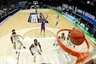 <p>Abilene Christian University faced off against No. 3 University of Texas in the final game of the men's NCAA Tournament and gave fans another stunner. The 14th seed Wildcats defeated Texas 53-52, sending home a team that was considered a lock for the Final Four. </p>
