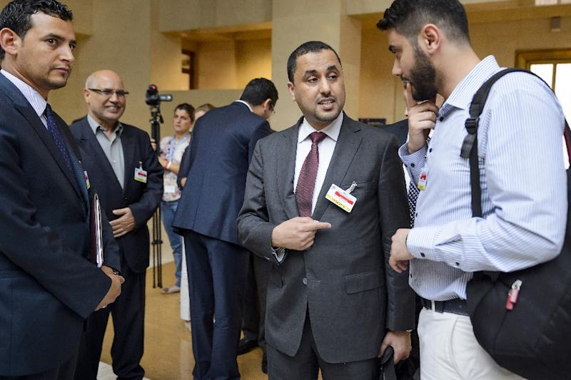 General National Congress deputy president Saleh al-Makzom (C) arrives with members of the delegation to hold Libya peace talks on August 11, 2015 at the UN Office in Geneva, Switzerland (AFP Photo/Fabrice Coffrini)
