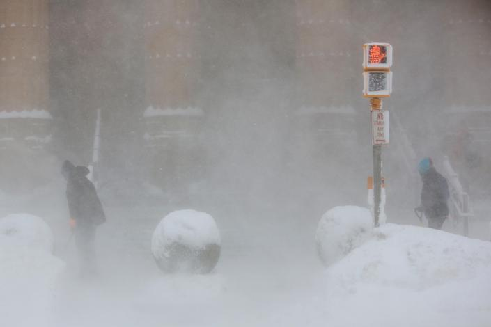 Workers shovel at the entrance to City Hall in whiteout conditions during a winter storm in Buffalo, N.Y. Jan 30, 2019. (Photo: Lindsay Dedario/Reuters)