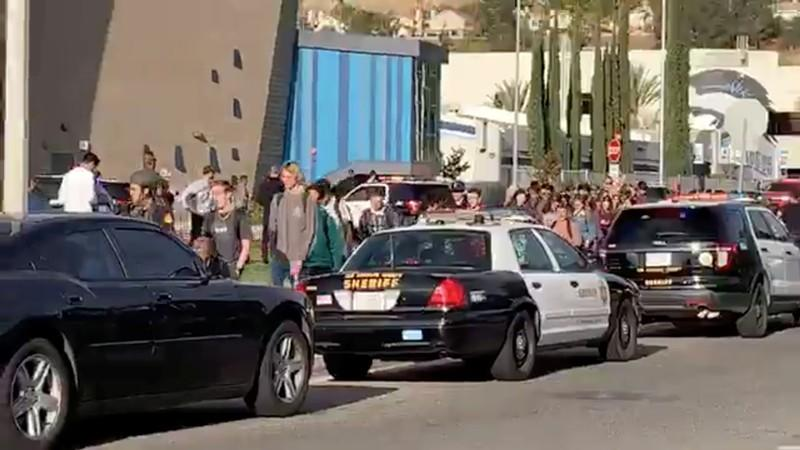 Sheriffs escort students and faculty out of Saugus High School in Santa Clarita, California