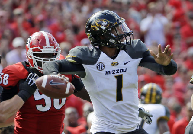 Missouri quarterback James Franklin throws from the pocket during the second half of an NCAA college football game against Georgia Saturday, Oct. 12, 2013, in Athens, Ga. Missouri won 41-26. (AP Photo/John Bazemore