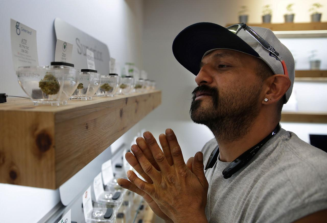 <p>Lucio Ortiz shops for marijuana at The Source dispensary, Saturday, July 1, 2017, in Las Vegas. Recreational marijuana became legal in Nevada on Saturday. (Photo: John Locher/AP) </p>