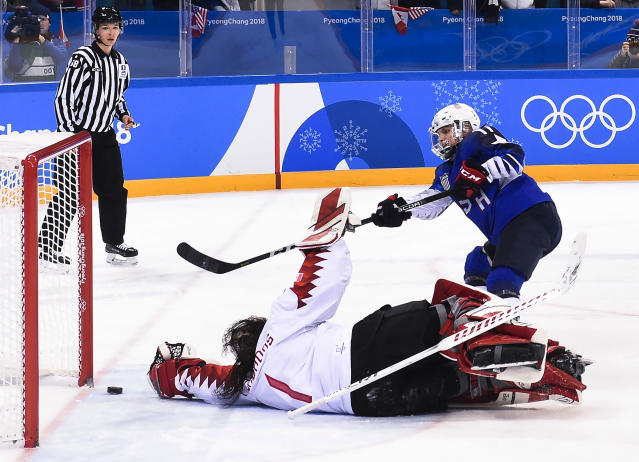 United States' Jocelyne Lamoureux (17) scores the game-winning goal in the shootout against Canada during the women's gold medal hockey game at the 2018 Winter Olympics in Gangneung, South Korea, Thursday, Feb. 22, 2018. (Nathan Denette/The Canadian Press via AP)