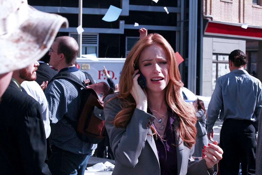 """Indelible"" -- On Sept. 11, 2001, Claire Taylor (Jaime Ray Newman) calls her husband, Mac, from the site of the World Trade Center attacks, in a flashback on the eighth season premiere of CSI: NY, Friday, Sept. 23 (9:00-10:00 PM, ET/PT) on the CBS Television Network. Photo: Richard Cartwright/CBS ©2011 CBS Broadcasting Inc. All Rights Reserved. <a href=""/baselineshow/4769320"">CSI: New York</a>"