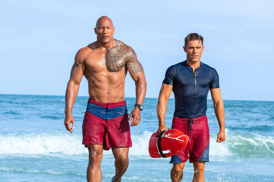 """Dwayne Johnson (left) and Zac Efron hit the beach for """"Baywatch."""""""
