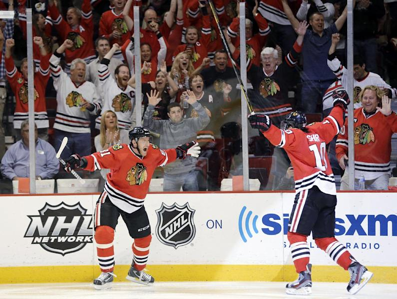 Chicago Blackhawks center Patrick Sharp (10) celebrates with right wing Marian Hossa (81) after scoring a goal against the Detroit Red Wings during the second period in Game 7 of the NHL hockey Stanley Cup Western Conference semifinals, Wednesday, May 29, 2013, in Chicago. (AP Photo/Nam Y. Huh)
