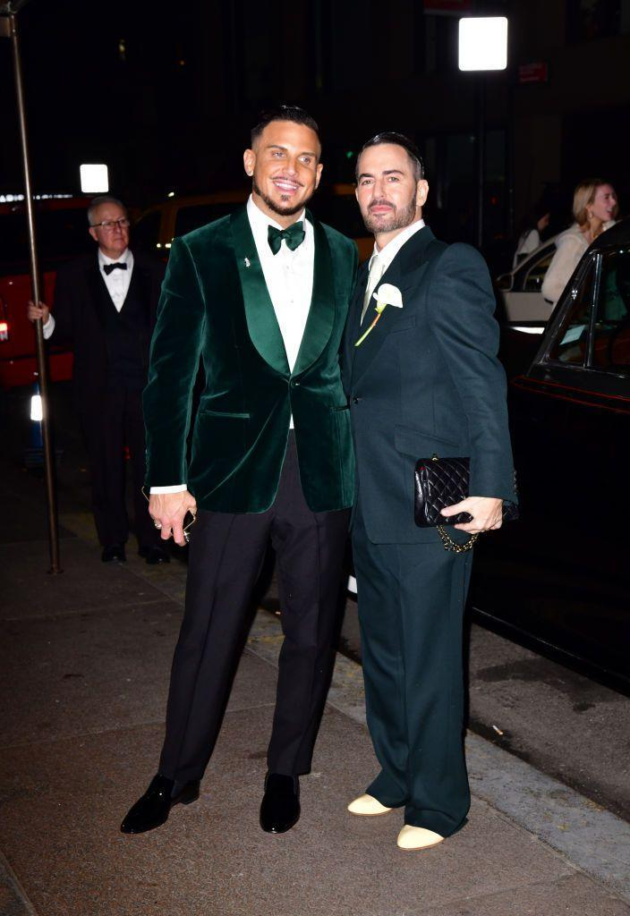 <p>The newlyweds posed outside their wedding reception venue.</p>