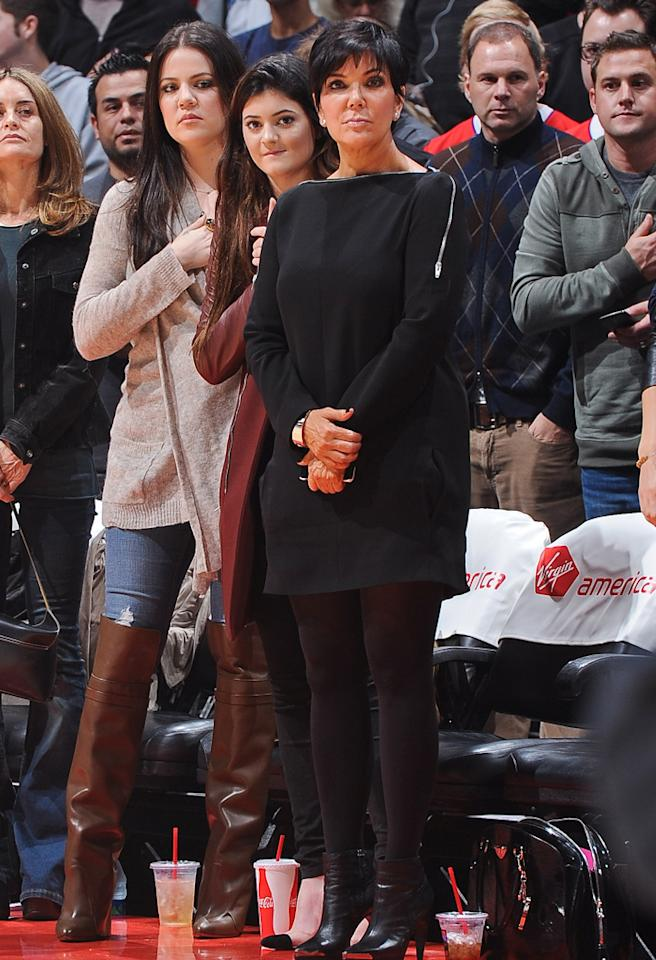LOS ANGELES, CA - NOVEMBER 26: Khloe Kardashian Odom, left, Kylie Jenner, center, and Kris Jenner attend a game between the New Orleans Hornets and Los Angeles Clippers at Staples Center on November 26, 2012 in Los Angeles, California. NOTE TO USER: User expressly acknowledges and agrees that, by downloading and/or using this Photograph, user is consenting to the terms and conditions of the Getty Images License Agreement. Mandatory Copyright Notice: Copyright 2012 NBAE (Photo by Andrew D. Bernstein/NBAE via Getty Images)