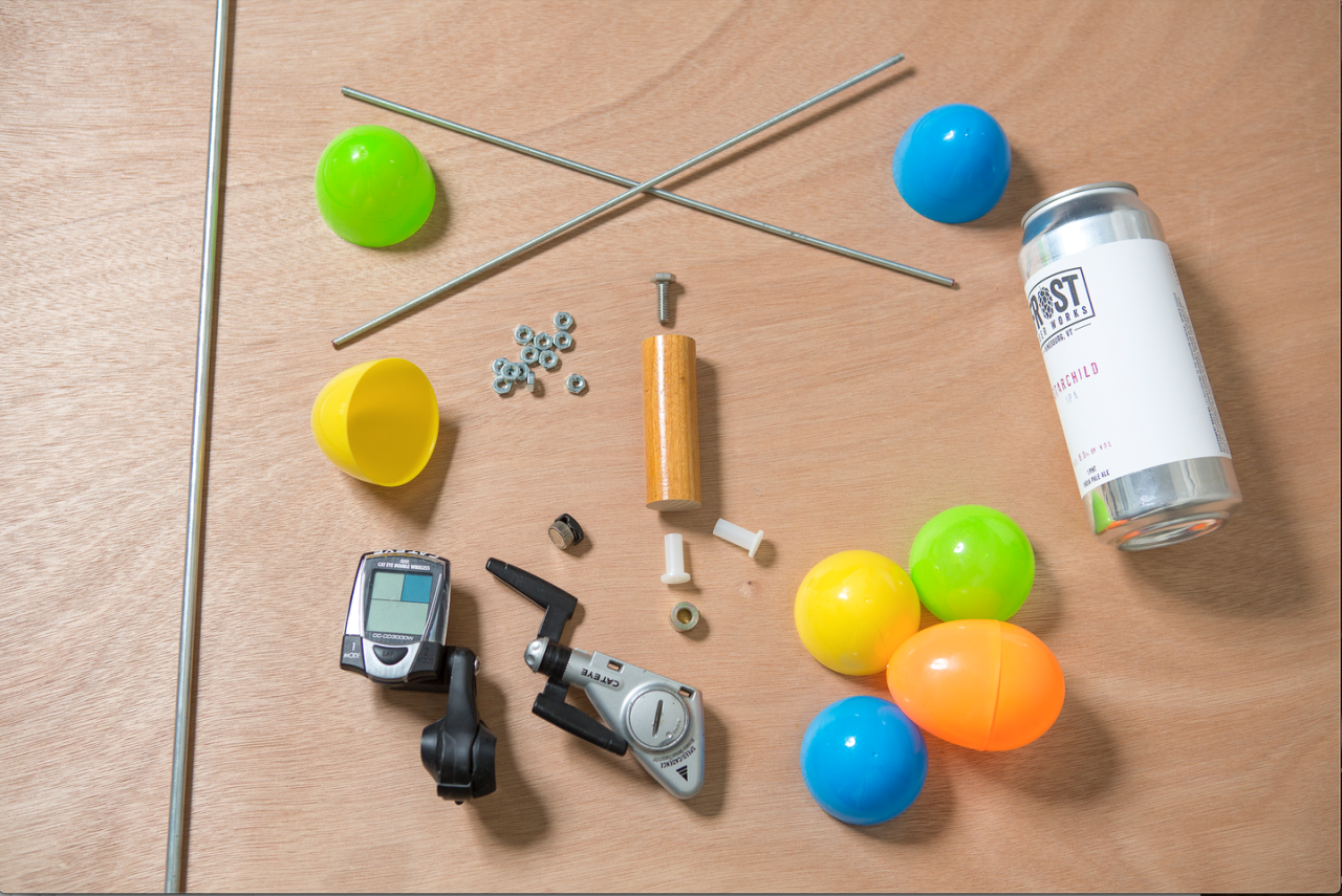 "<p>1 ¼"" dowel, 12"" long<br>2 8–32 threaded rods, 12"" long<br>2 ¼"" nylon bushings<br>12 8–32 hex nuts<br>4 plastic Easter eggs<br>1 1"" dowel, 3"" long<br>1 ¼"" rod collar<br>1 ¼"" x 20 bolt<br>1 empty aluminum can<br>1 bicycle speedometer<br>zip ties<br>contact cement</p>"