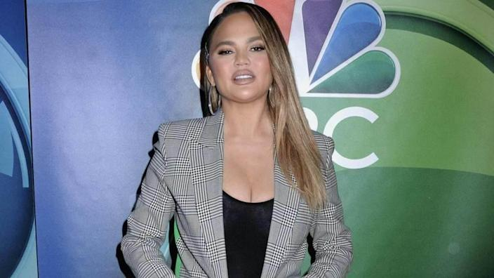 Chrissy Teigen Shares Nude Baby Bump Throwback Pic for