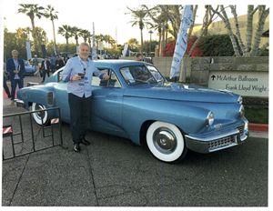 Stephen Tebo poses with the Tucker 48, commonly referred to as the Tucker Torpedo. The vehicle is one of only 47 in existence and on display at Tebo's Garage.