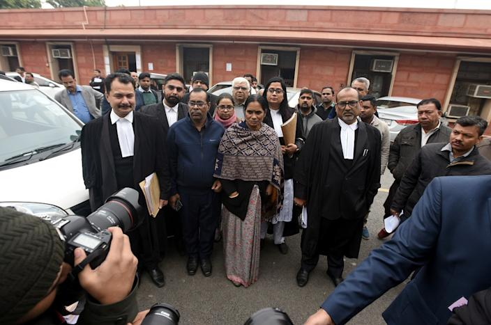 Badrinath Singh (in blue) and Asha Devi, parents of the December 16 gang rape case victim, leave Supreme Court ahead of the hearing on the review plea filed by Akshay Kumar Singh, one of the convicts in the 2012 case on December 17, 2019 in New Delhi, India. (Photo by Sonu Mehta/Hindustan Times via Getty Images)