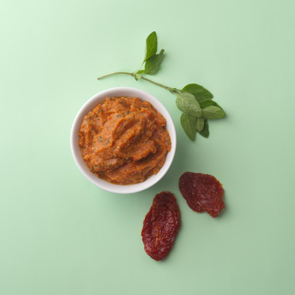 <p>In the '70s, with the advent of New American cooking, sun-dried tomato pesto became something of a cliché-and was summarily forgotten on the culinary landscape. It's well worth a revival, especially when you cut down the fat and add a little vinegar for a nice spike.</p>