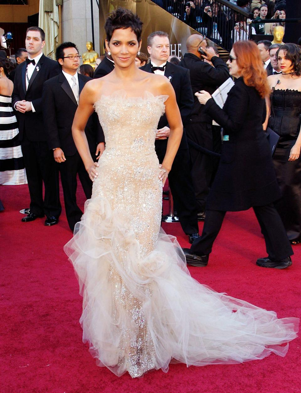 <p>Halle Berry has worn her fair share of show-stopping red carpet gowns through the years, and her 2011 Marchesa was no exception. </p>