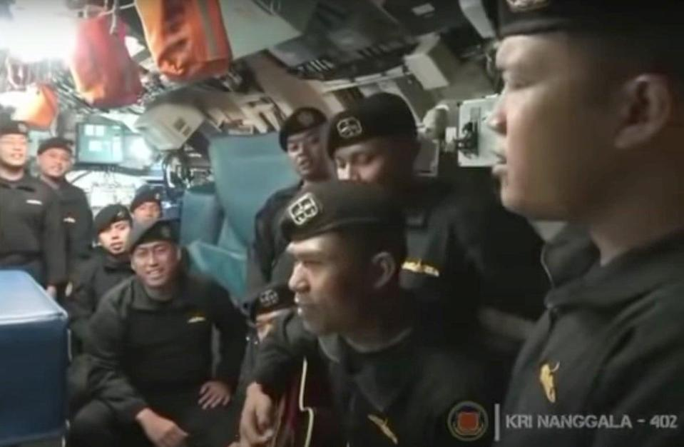 Video showing the crew of a sunken Indonesian submarine singing on board their vessel (Indonesian military)