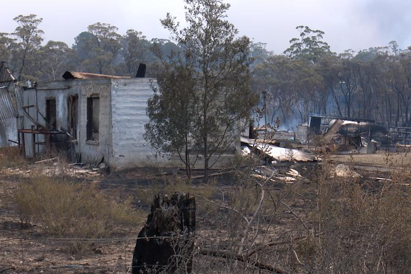 Burnt-out property is seen following the Green Wattle Creek Fire at Buxton.