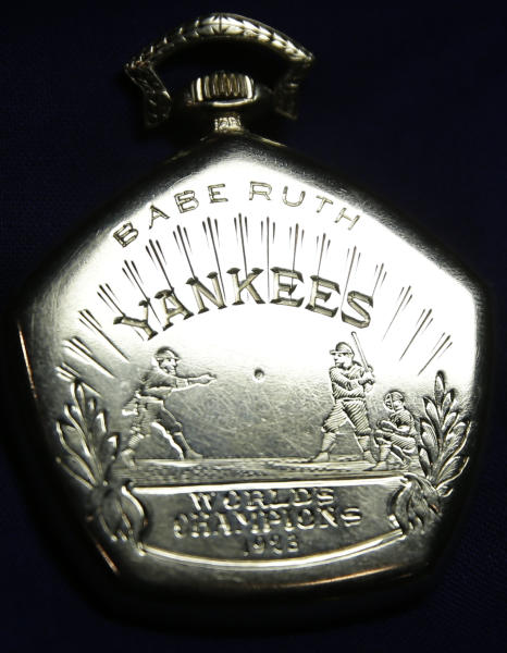 FILE - A pocket watch that was given to Babe Ruth in 1923 is displayed at Heritage Auctions office in Dallas, in this Jan. 22, 2014 file photo. The watch from the 1923 World Series sold for $717,000 Saturday Feb. 22, 2014 at auction in New York City. Ruth batted .368 and hit three home runs in the series, the first of the Yankees' 27 world championships. (AP Photo/LM Otero, File)