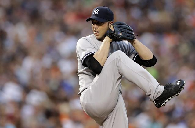 New York Yankees starting pitcher Chris Capuano throws to the Baltimore Orioles in the first inning of a baseball game, Monday, Aug. 11, 2014, in Baltimore. (AP Photo/Patrick Semansky)