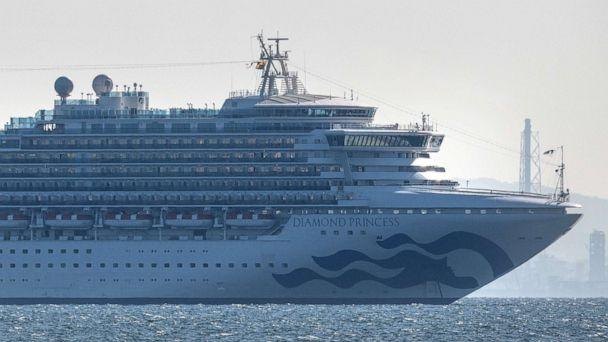 PHOTO: The Diamond Princess cruise ship with around 3,700 people on board sits anchored in quarantine off the Japanese port of Yokohama on Feb. 5, 2020, after a number of passengers tested positive for the new coronavirus. (Carl Court/Getty Images)