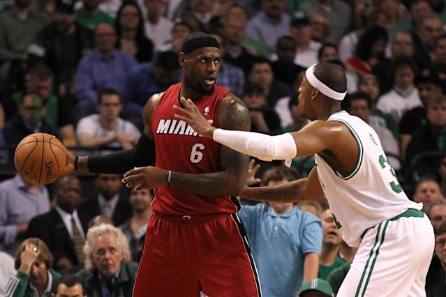 BOSTON, MA - JUNE 07: LeBron James #6 of the Miami Heat looks to pass in the first quarter against Paul Pierce #34 of the Boston Celtics in Game Six of the Eastern Conference Finals in the 2012 NBA Playoffs on June 7, 2012 at TD Garden in Boston, Massachusetts. NOTE TO USER: User expressly acknowledges and agrees that, by downloading and or using this photograph, User is consenting to the terms and conditions of the Getty Images License Agreement. (Photo by Jim Rogash/Getty Images)