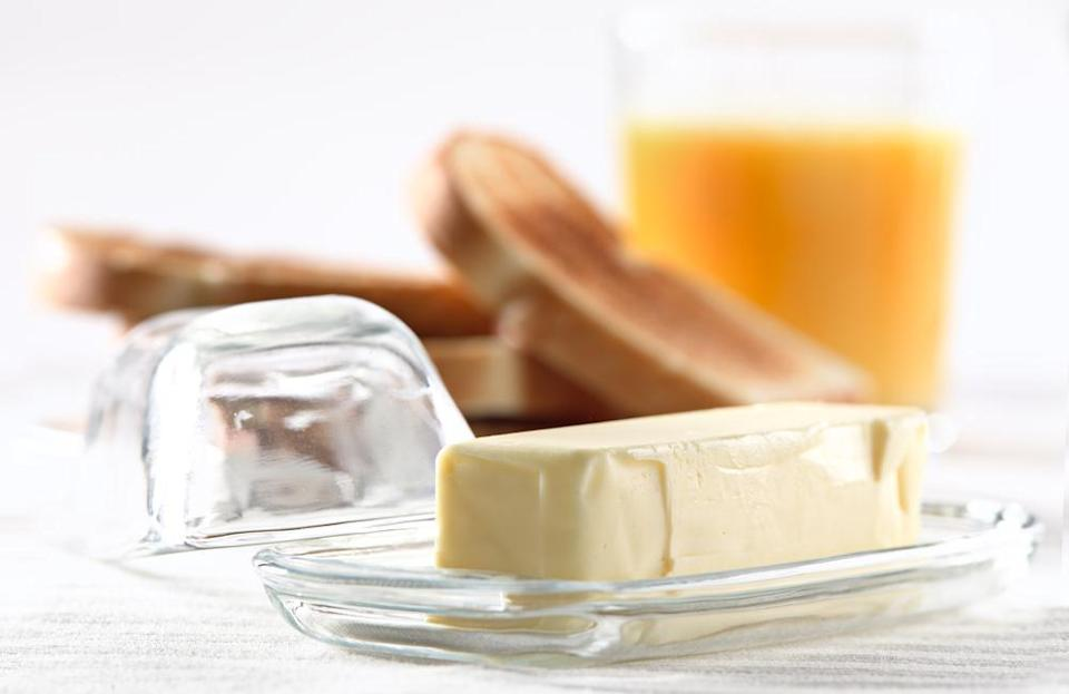 """<p>It may be tempting to keep your butter on the counter so it gets silky and spreadable for making <a href=""""https://www.thedailymeal.com/cook/how-make-perfect-grilled-cheese-sandwich-and-12-ways-make-it-even-better-slideshow?referrer=yahoo&category=beauty_food&include_utm=1&utm_medium=referral&utm_source=yahoo&utm_campaign=feed"""" rel=""""nofollow noopener"""" target=""""_blank"""" data-ylk=""""slk:grilled cheese"""" class=""""link rapid-noclick-resp"""">grilled cheese</a> and spreading over toast. But you might be wondering: won't it go bad? It sure will. According to <a href=""""https://www.landolakes.com/expert-advice/how-long-does-butter-last/?referrer=yahoo&category=beauty_food&include_utm=1&utm_medium=referral&utm_source=yahoo&utm_campaign=feed"""" rel=""""nofollow noopener"""" target=""""_blank"""" data-ylk=""""slk:Land O'Lakes"""" class=""""link rapid-noclick-resp"""">Land O'Lakes</a>, you shouldn't leave butter at room temperature for more than four hours; you should store it wrapped or in a butter dish in your fridge. You can also freeze butter. When butter has gone bad, you'll know because it will taste slightly stale with a sour smell.</p>"""