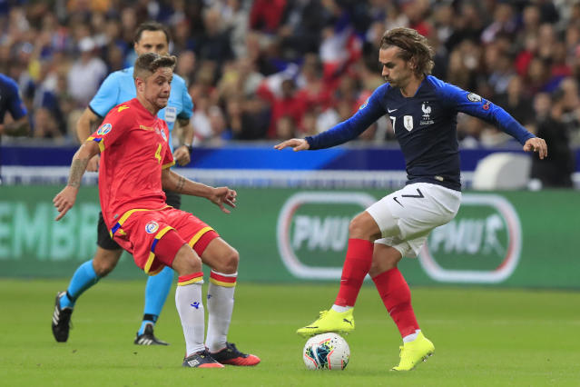 France's Antoine Griezmann, right, vies for the ball with Andorra's Marc Rebes during the Euro 2020 group H qualifying soccer match between France and Andorra at the Stade de France in Saint Denis, north of Paris, France, Tuesday, Sept. 10, 2019. (AP Photo/Michel Euler)