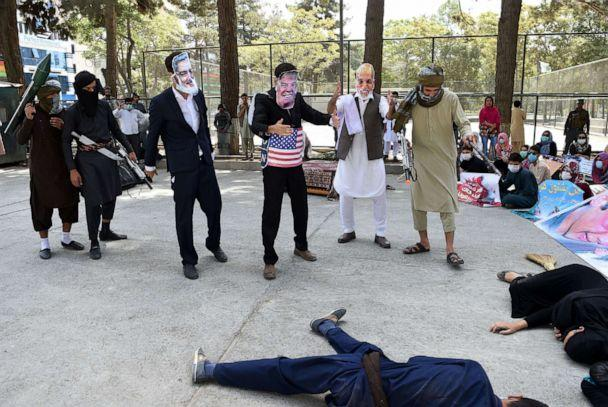 PHOTO: In this Aug. 11, 2017, file photo, protesters wear masks of Afghan Chief Executive Abdullah Abdullah (L) and US President Trump (C) and Afghan President Ashraf Ghani (2R) to protest against the Afghan government and Taliban militants, in Kabul. (Wakil Koshar/AFP via Getty Images, FILE)