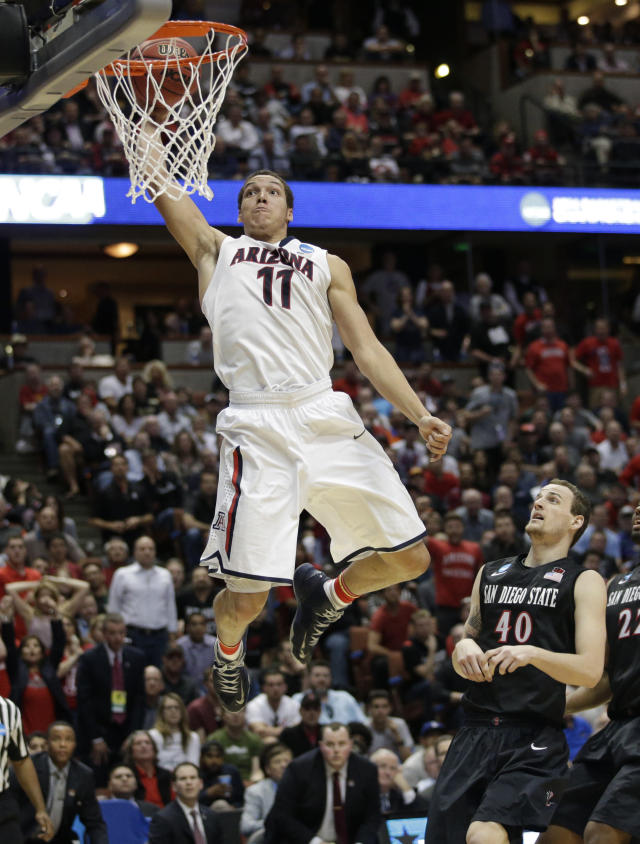 Arizona forward Aaron Gordon (11) dunks as San Diego State forward Matt Shrigley (40) watches during the second half in a regional semifinal of the NCAA men's college basketball tournament, Thursday, March 27, 2014, in Anaheim, Calif. (AP Photo/Jae C. Hong)