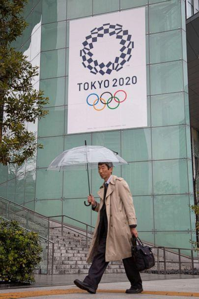 PHOTO: A man walks by the headquarters for the Tokyo Organizing Committee of the Olympic and Paralympic Games in Tokyo, Japan, on March 2, 2020. (Anthony Trotter/ABC News)