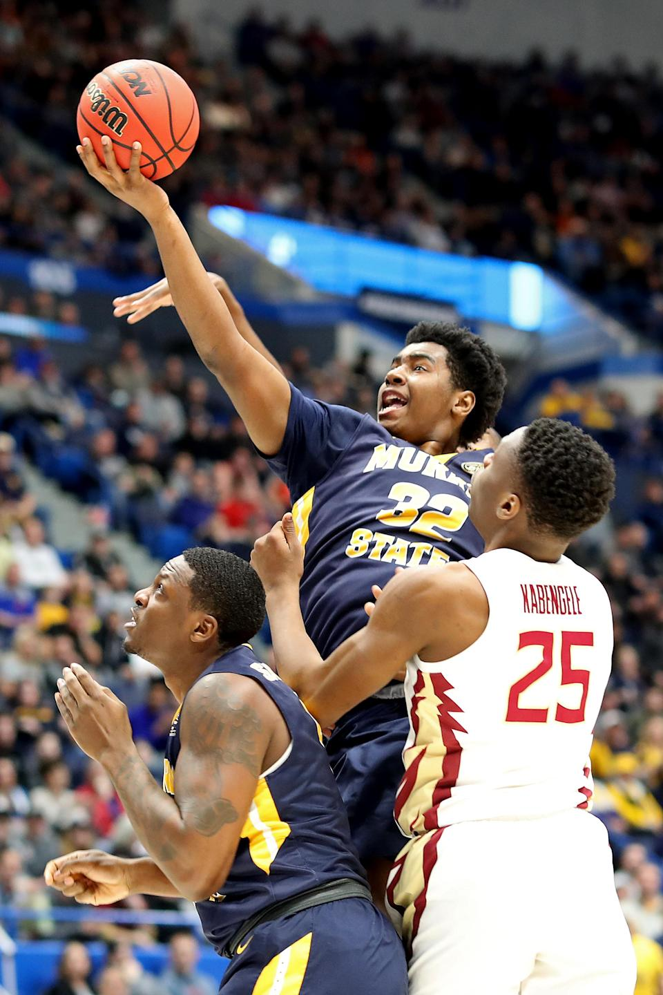 <p>Darnell Cowart #32 of the Murray State Racers attempts a shot against Mfiondu Kabengele #25 of the Florida State Seminoles in the first half during the second round of the 2019 NCAA Men's Basketball Tournament at XL Center on March 23, 2019 in Hartford, Connecticut. (Photo by Rob Carr/Getty Images) </p>