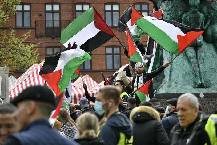 People holding placards and Palestinian flags march in solidarity with the Palestinian people amid the ongoing conflict with Israel, during a demonstration in Malmo, Sweden, Saturday May 15, 2021. (Johan Nilsson/TT via AP)