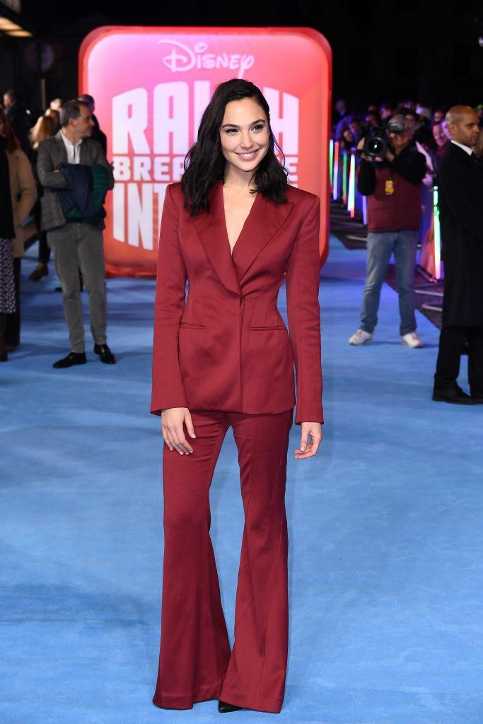 <p>Gal Gadot gave lessons in festive party dressing at the premiere of 'Ralph Breaks The Internet' in London on November 25. Hands up, who else is now on the hunt for a berry co-ord? <em>[Photo: Getty]</em> </p>